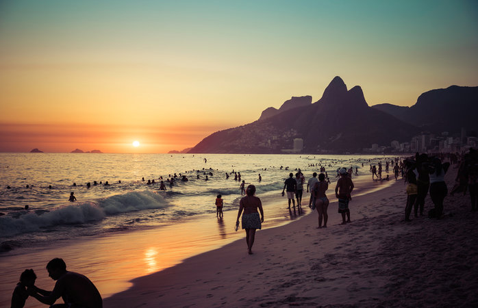 Rio deJaneiro, Brazil - January 19, 2014: People relaxing on Ipanema Beach during beautiful sunset.